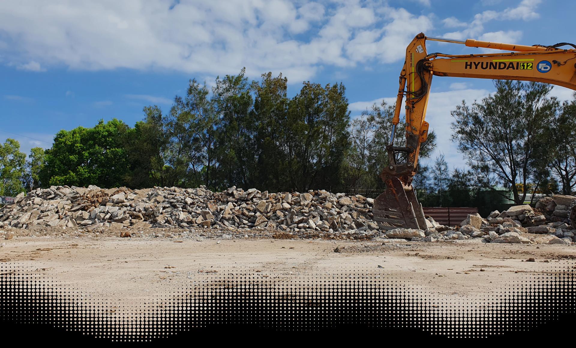 Excavator on site full of rocks