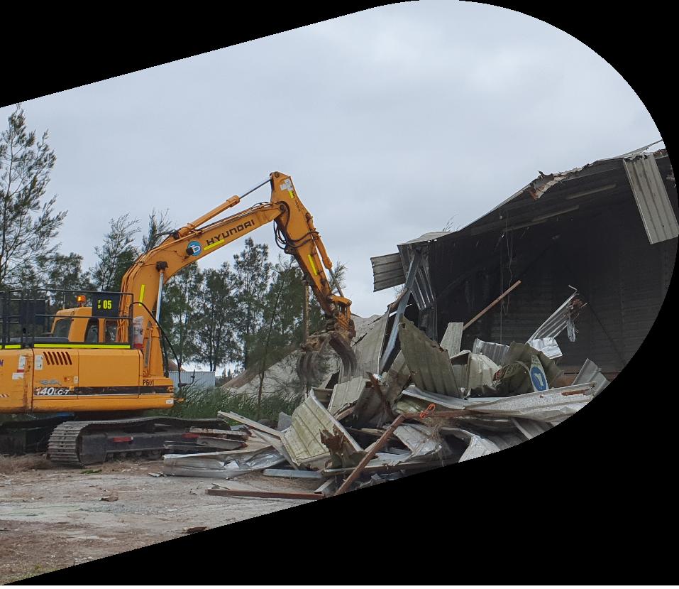 Excavator demolishing old structures