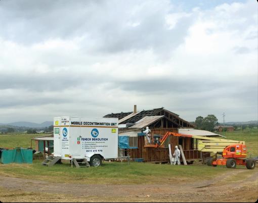 Fenech Demolition mobile decontamination unit outside of a construction site