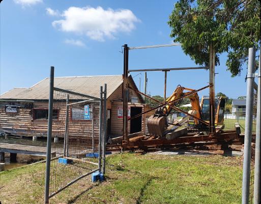 Excavator demolishing
